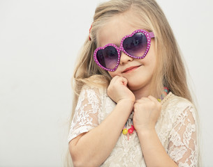 Little model with sunglasses .