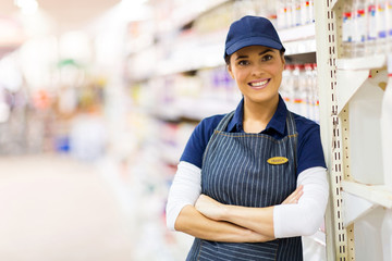 female supermarket shop assistant