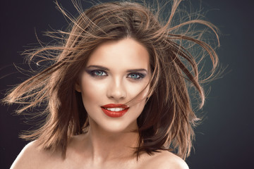 Female model with long hair in motion.