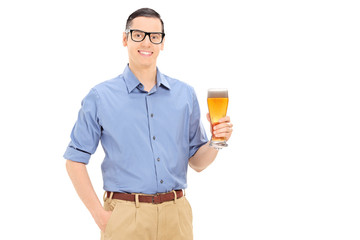Young man holding a pint of beer