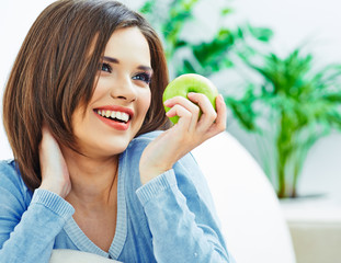 Woman with white healthy teeth smiling, hold green apple.