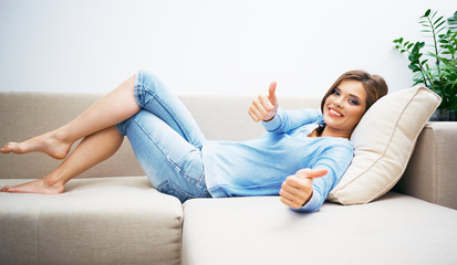 Woman lying on sofa show thumb