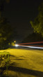 Road at night with car light trail in rural Malaysia
