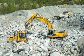 Excavators digging