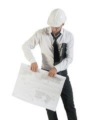 Young handsome contractor rolling up plans isolated on white
