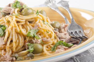 spaghetti with tuna, olive and basil