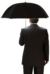 Mature businessman holding an umbrella