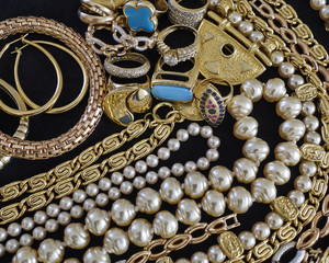 pirate's gold, variety of precious jewelry closeup