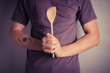 Man holding spoon