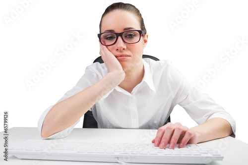Businesswoman typing on a keyboard