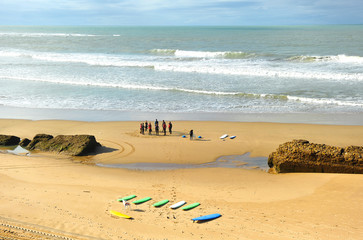 Group of surfers on the beach, learning, Cadiz, Spain