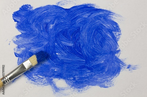 Blue paint with paintbrush