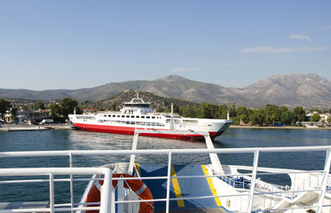 Ferryboat entering the habour of a greek island