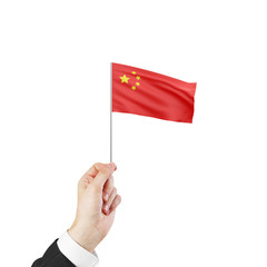 hand holding flag of China