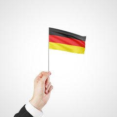 hand holding flag of  Germany