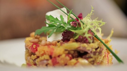 Couscous with meat, feta cheese and pine nuts