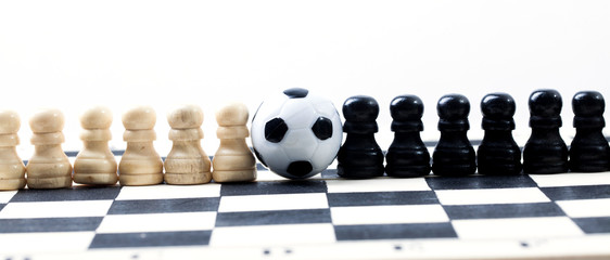chess figures play footboll on a chessboard