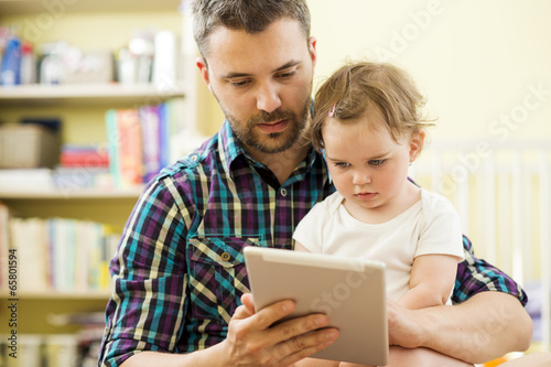 Father and daughter with tablet - 65801594