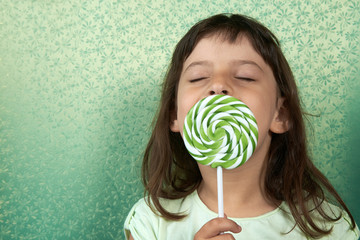 girl enjoy licking a lollipop.