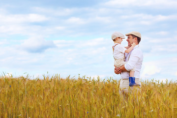 happy farmer family on wheat field