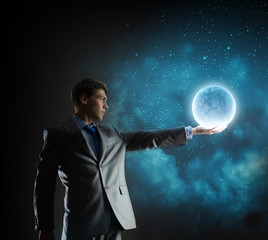 Businessman with moon