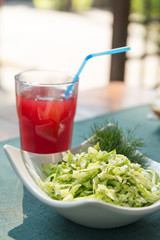 Fresh cabbage salad and cranberry juice