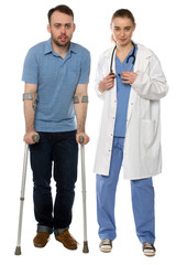 Smiling Disabled Man and Female Doctor Standing