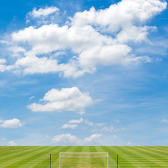 soccer field with blue sky background