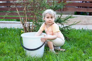 Small girl helping in the garden