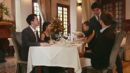 16of26 People eating at restaurant, business dinner, men, women