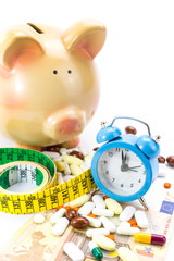 Piggy bank with pile of pills, banknotes clock and measure tape