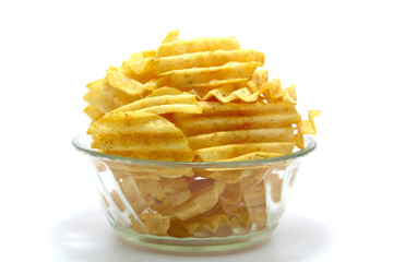 Delicious potato chips in bowl on a white background