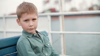 little boy dreams of standing near the water