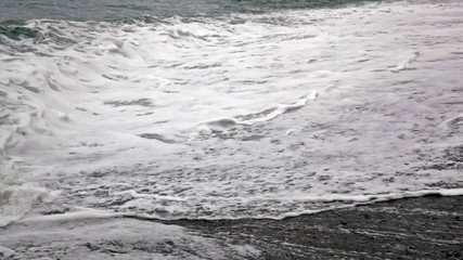 Sea wave runs on the beach coast
