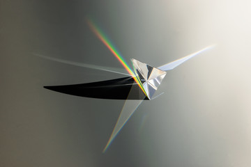 glass prism with spectrum and shadow