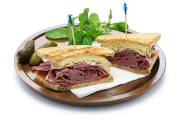 reuben sandwich with pastrami and swiss cheese