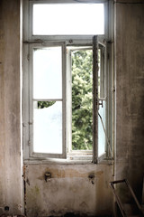 Window in an old empty and abandoned house