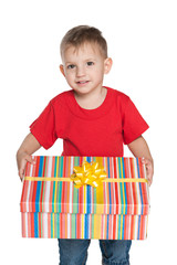 Smiling little boy holds a gift box