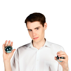 young man with blue shiny balls in hands isolated on white backg