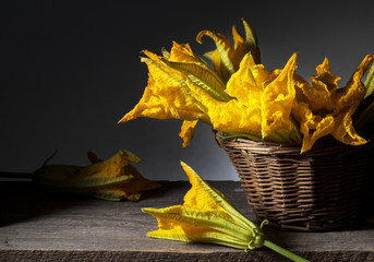 zucchini flowers on the wooden table