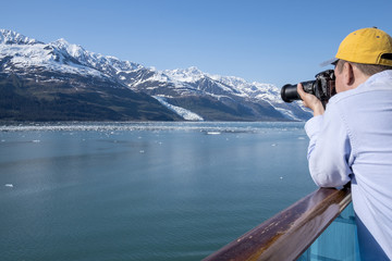 Photographer Making Photos of Glaciers in Alaska