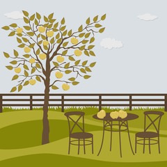 Rural landscape with apple tree and table and chairs