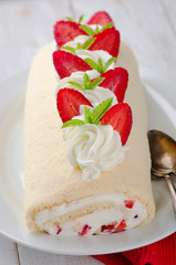 Homemade cake roll with strawberry
