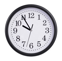 Office clock shows five to ten