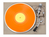 Turntable with orange record, isolated on white background