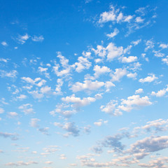 many small white clouds in blue sky
