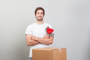 Young man while he is packing preparing to move house.
