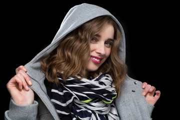 Happy flirtatious woman in a hooded jacket
