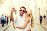 smiling couple with smartphone in the city - Fine Art prints
