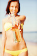 girl with bottle of drink on the beach